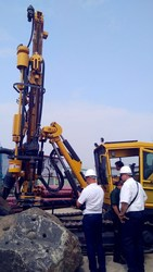 Uzbekistan customer check the drilling performance of ROCX5 DTH hydraulic crawler rock drilling rig